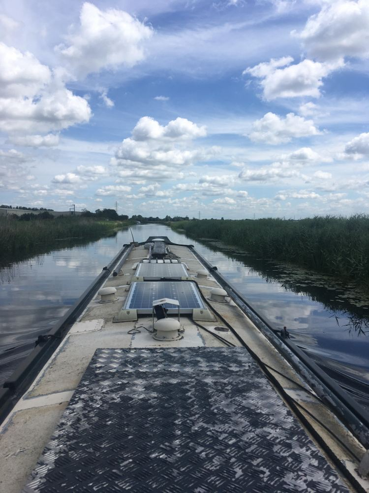 View from stern of narrowboat on the Old River Nene